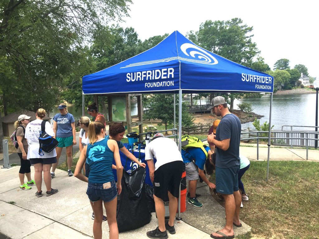 volunteers picking up trash and litter from lake wylie shoreline